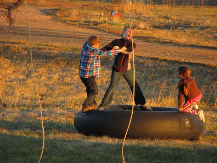 Small town fun:  Using a combine inner-tube as a trampoline.